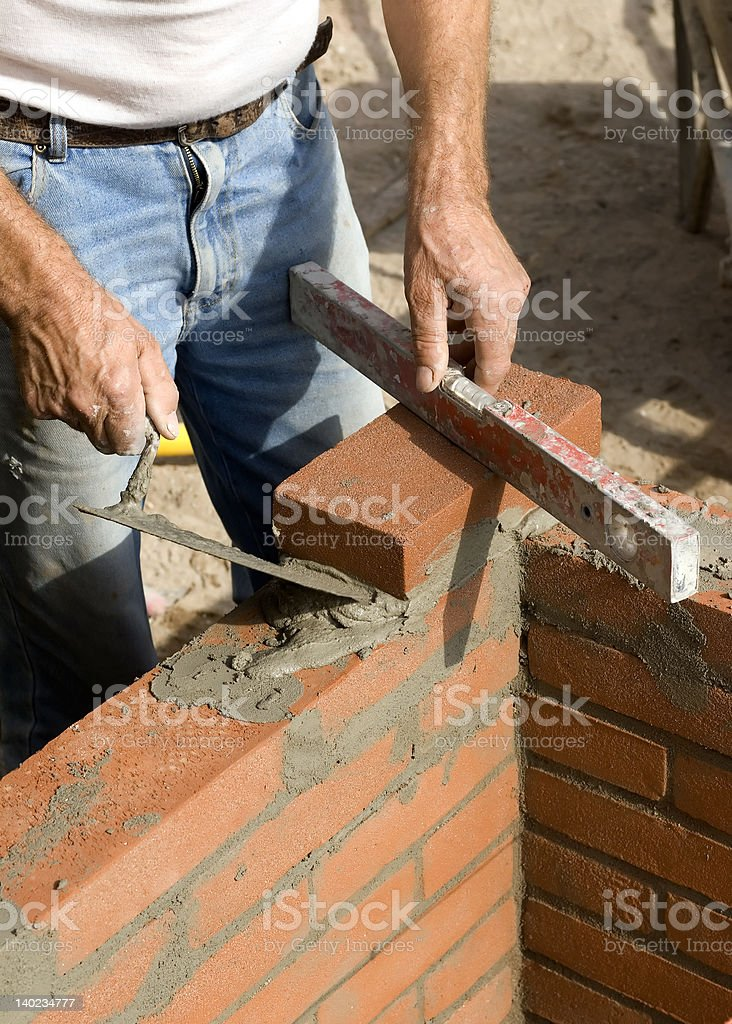 Brick layer with tools and mortar royalty-free stock photo
