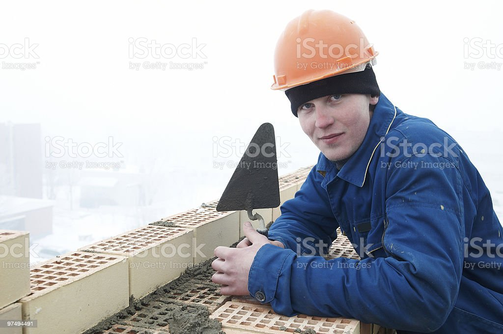 Brick layer worker builder mason royalty-free stock photo