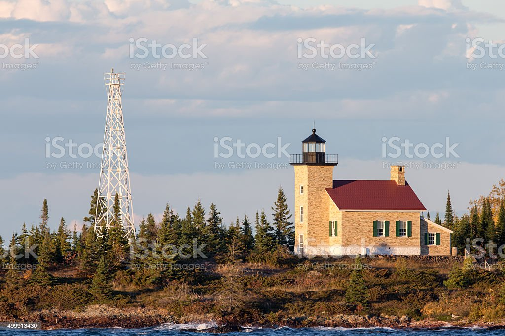 Brick Lighthouse with Red Roof in Warm Light stock photo