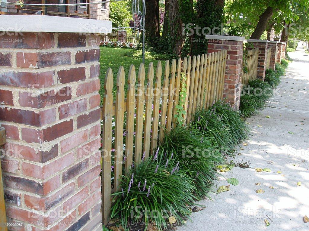 Brick & Picket Fence stock photo