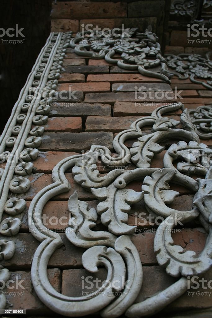 Brick Pier with a vine designed pargeting stock photo