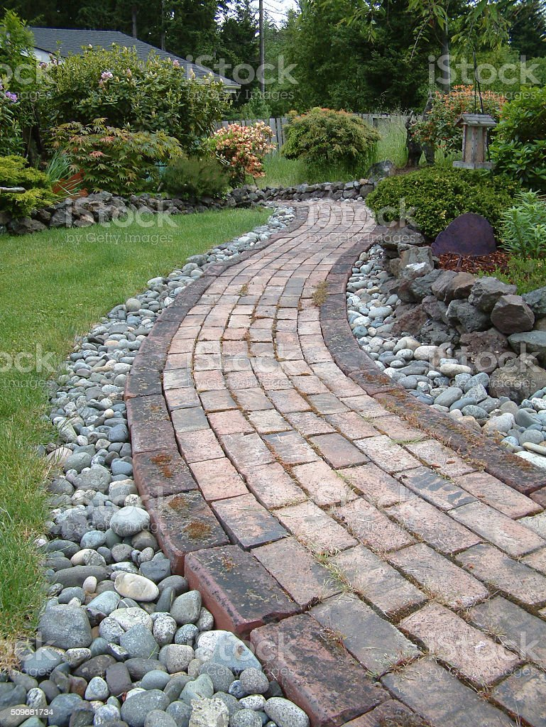 Brick Sidewalk Landscaped In The Front Yard Of A Residence stock photo