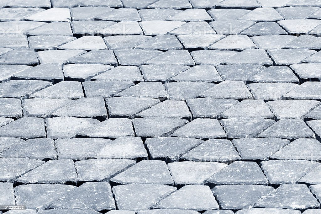 Brick sidewalk, made from plain interlocking concrete bricks stock photo