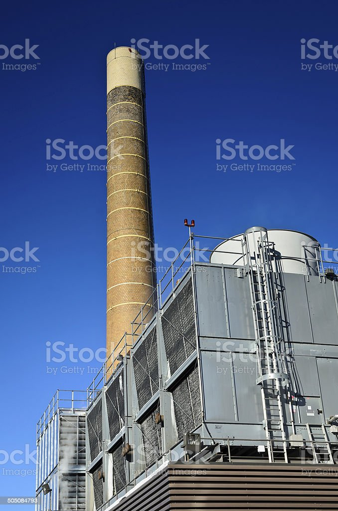 brick smokestack and clear blue sky royalty-free stock photo