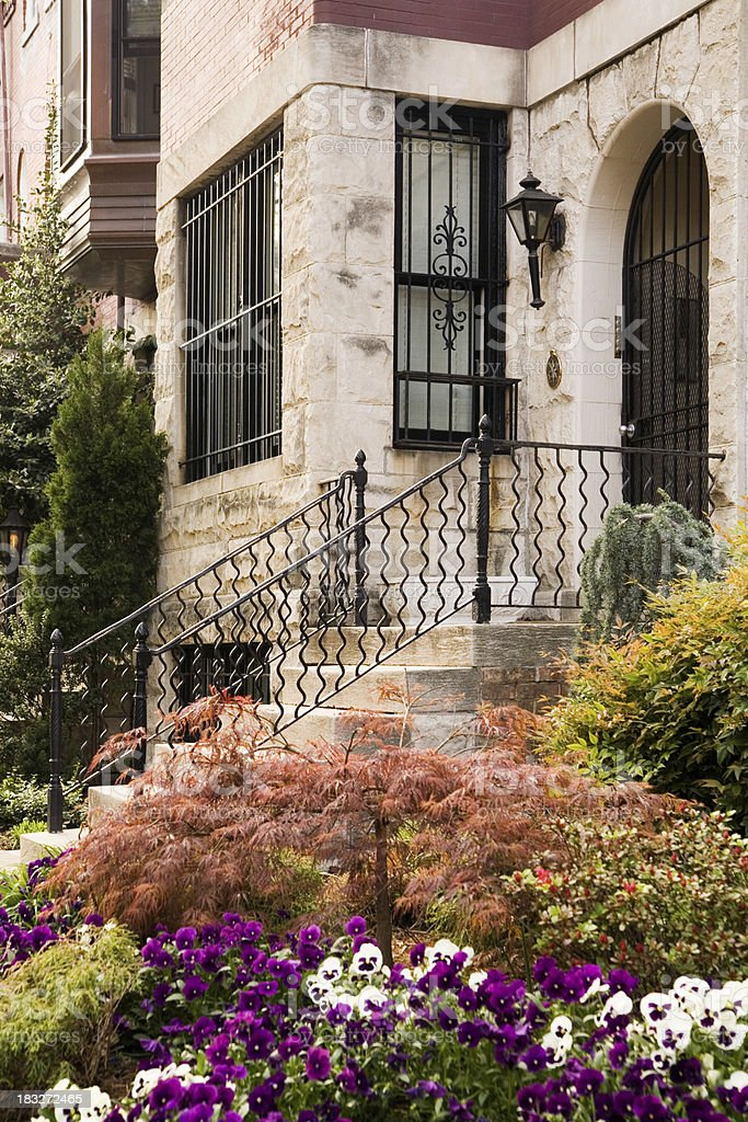 Brick Town House and Flower Beds stock photo