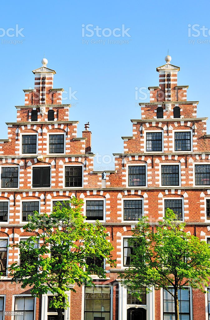 Brick Twin Houses Against Clear Blue Sky, Haarlem, The Netherlands stock photo