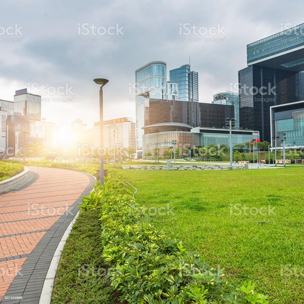 brick walkway through green office block in Hong Kong stock photo