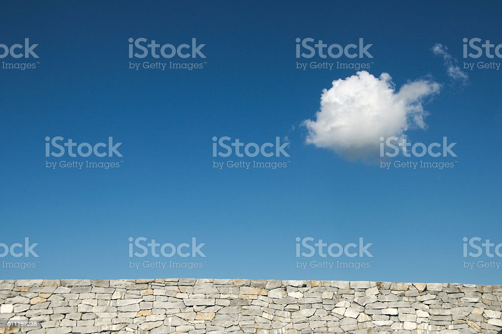 Brick Wall and Blue Sky with Cloud stock photo