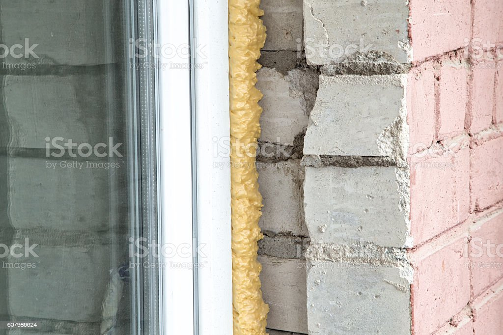 Brick wall and new window stock photo