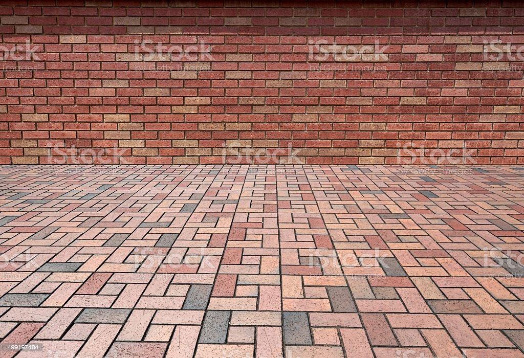 Brick wall and paving brick texture background stock photo