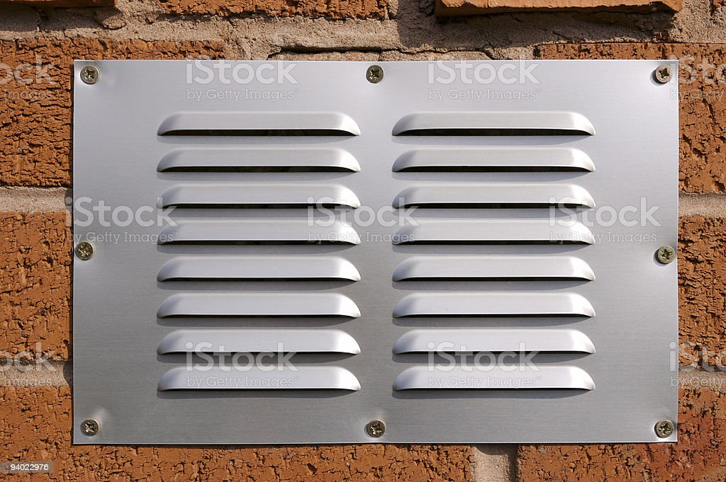 Brick wall and Ventilation Grille royalty-free stock photo