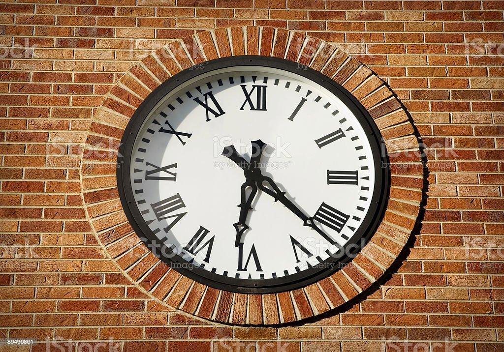 brick wall clock stock photo