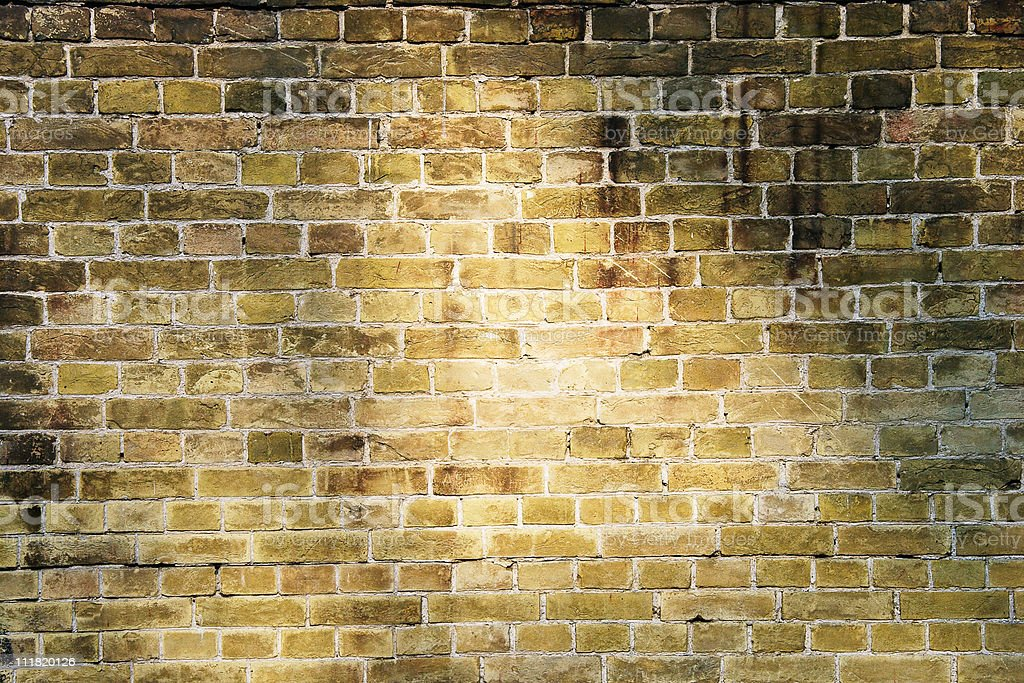Brick wall lighted sun beams royalty-free stock photo