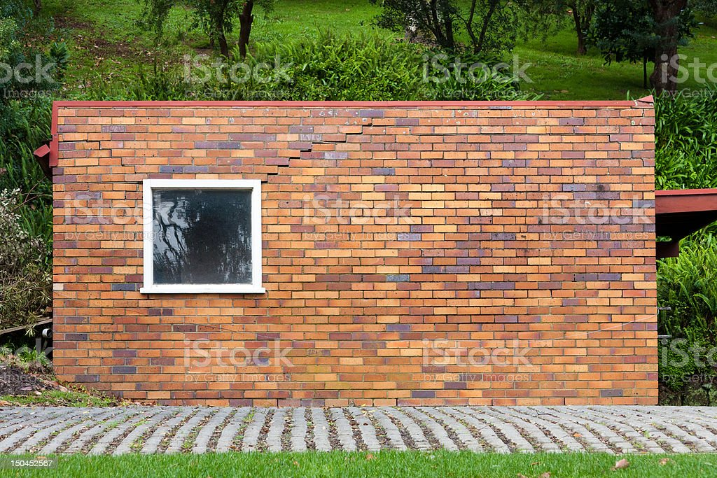 Brick wall on green background royalty-free stock photo