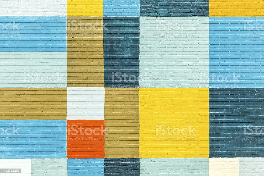 brick wall painted in rainbow colors stock photo