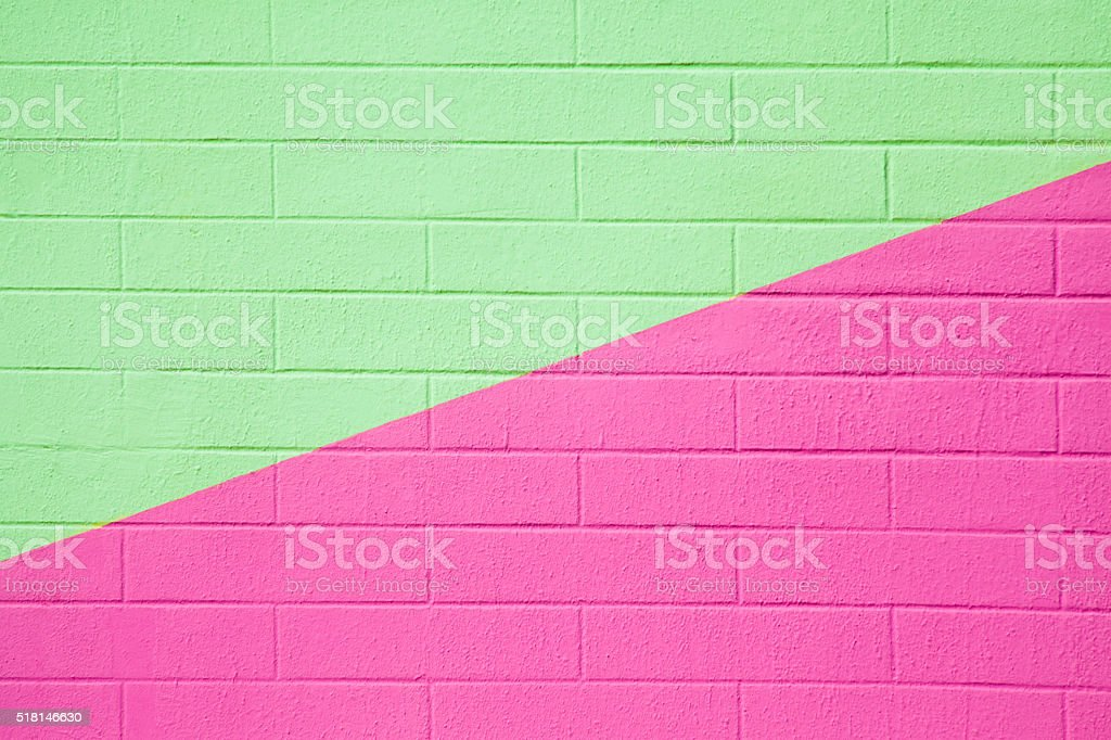 Brick wall painted pink and green, background full frame. stock photo