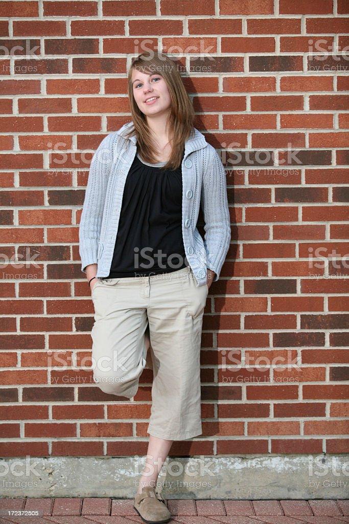 brick wall teen girl stock photo