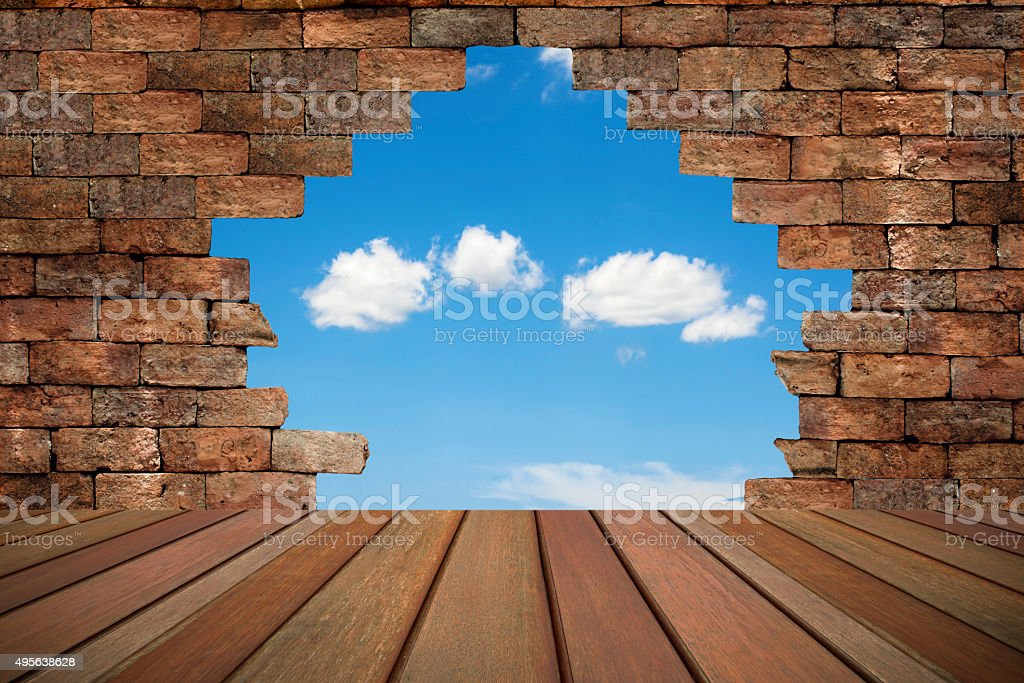 brick wall with a hole. Leadership concept royalty-free stock photo