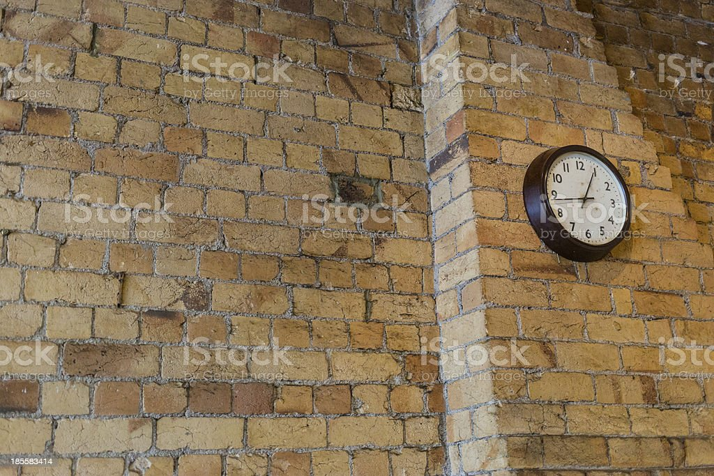 Brick wall with an old clock royalty-free stock photo