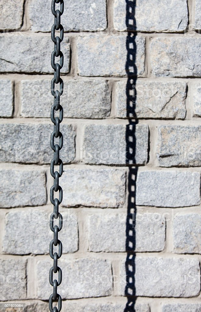 Brick Wall with Chain stock photo