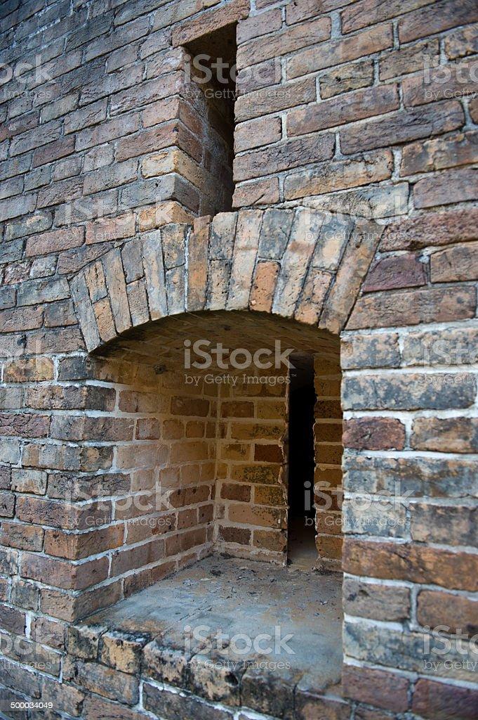 Brick wall with gun slots stock photo