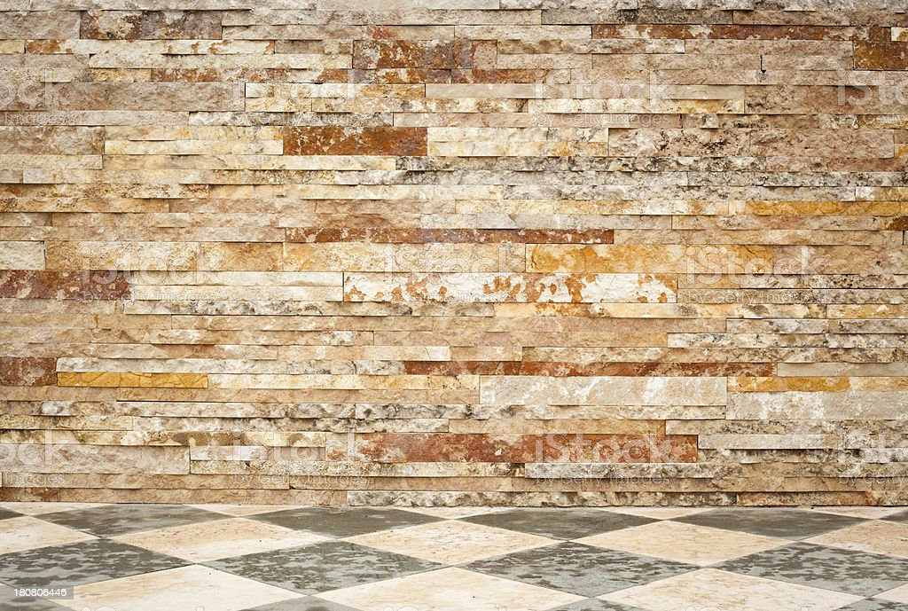 Brick Wall With Marble Sidewalk royalty-free stock photo