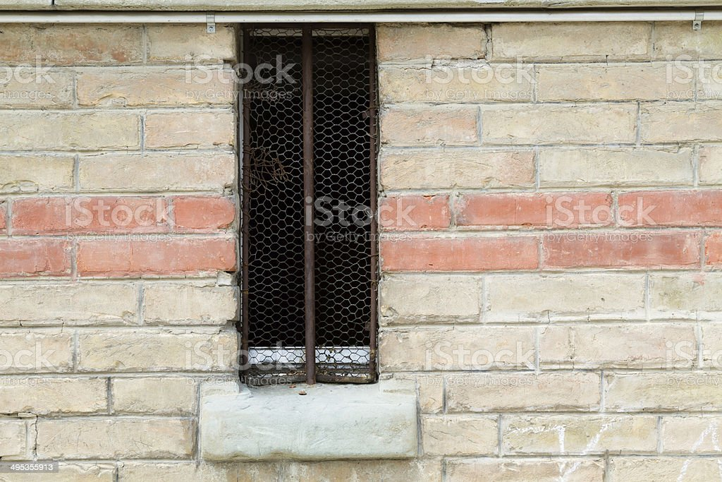 brick wall with old window stock photo