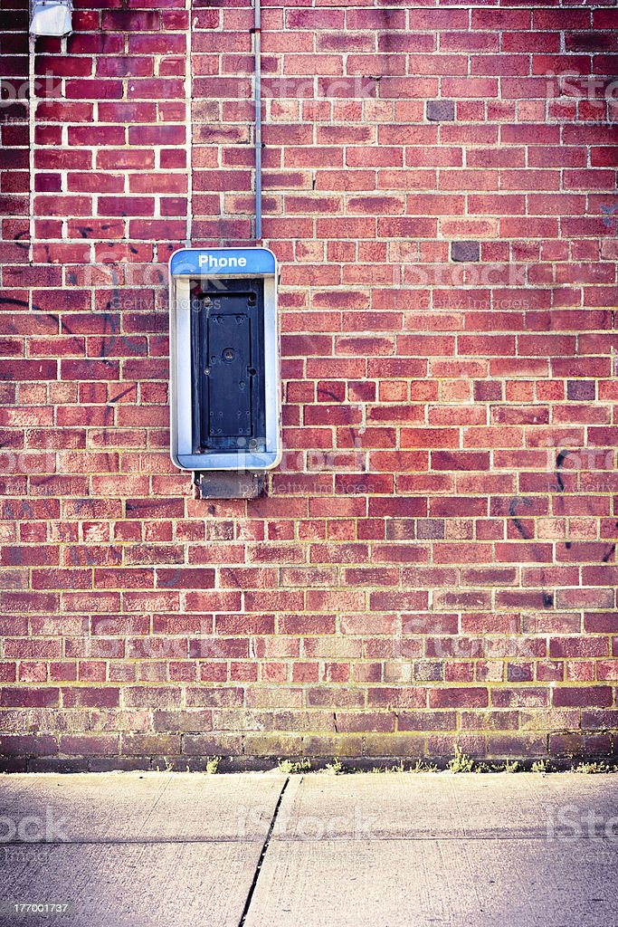 Brick Wall with Payphone stock photo