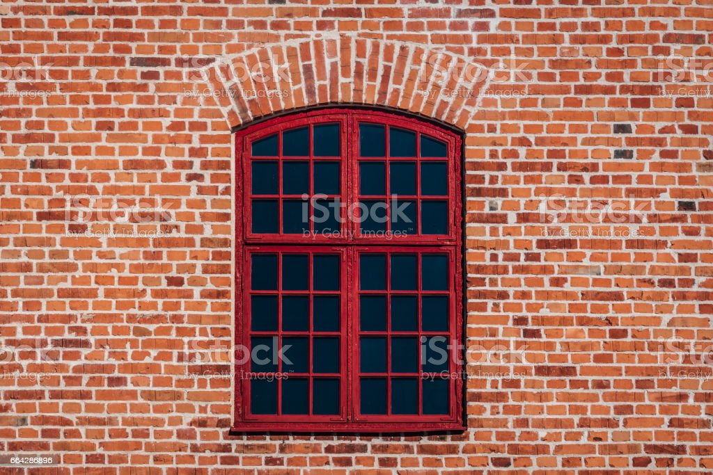 Brick wall with red window stock photo