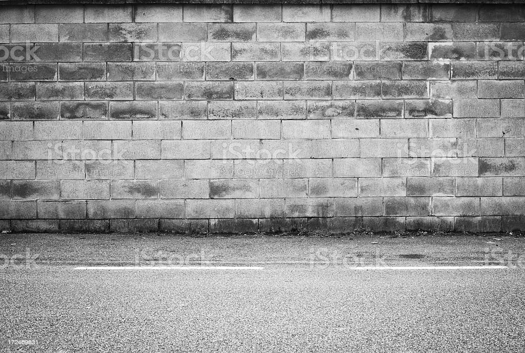 Brick Wall With Sidewalk, Black And White royalty-free stock photo