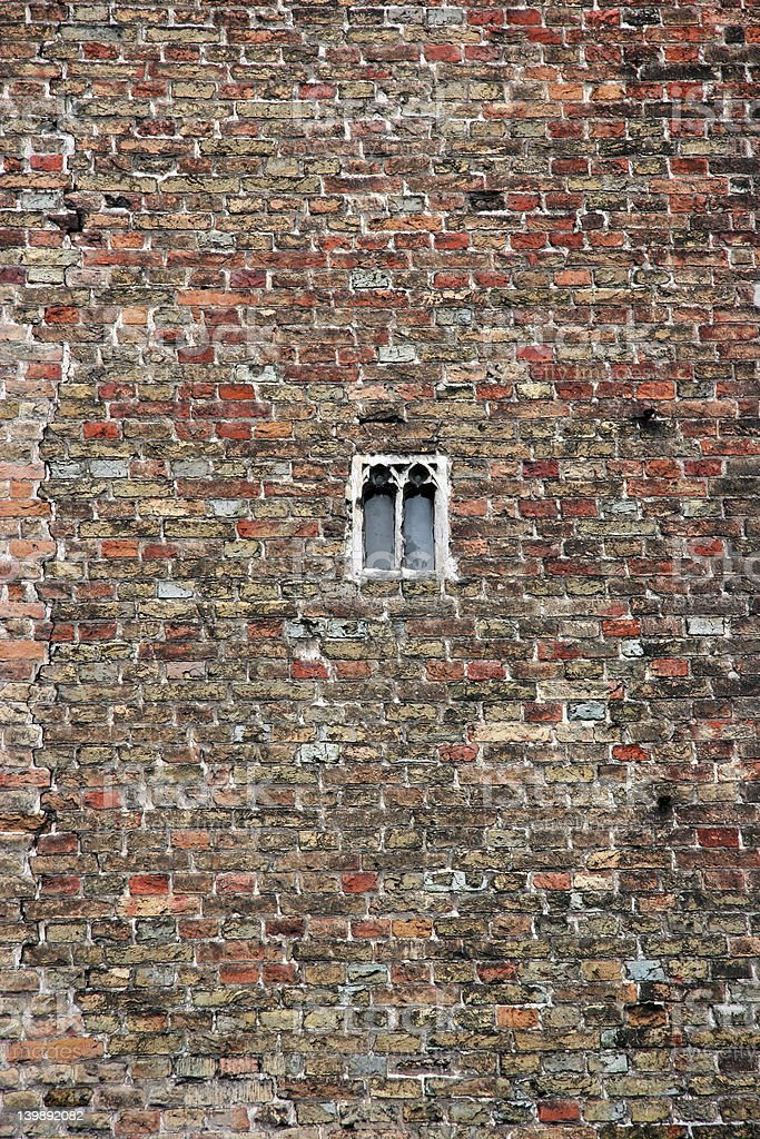 Brick wall with small window stock photo