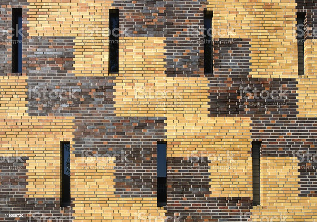 Brick wall with small windows stock photo