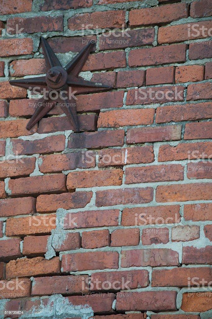 Brick wall with star bolt stock photo
