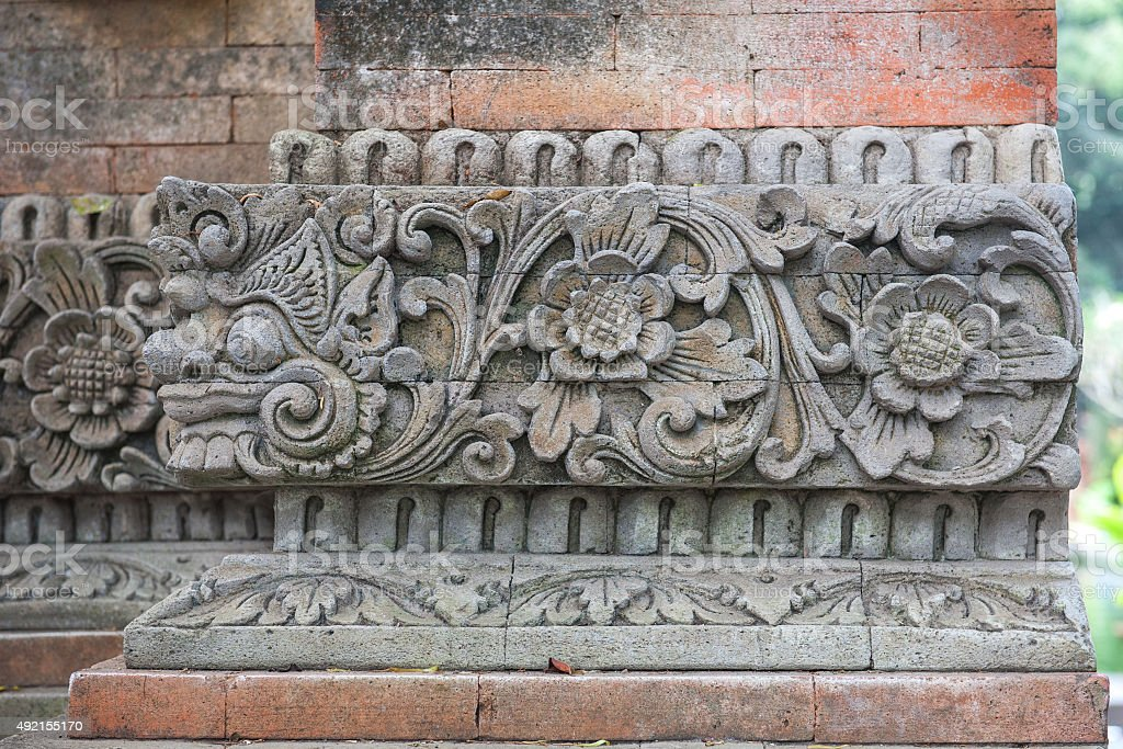 Brick wall with stone carving. stock photo