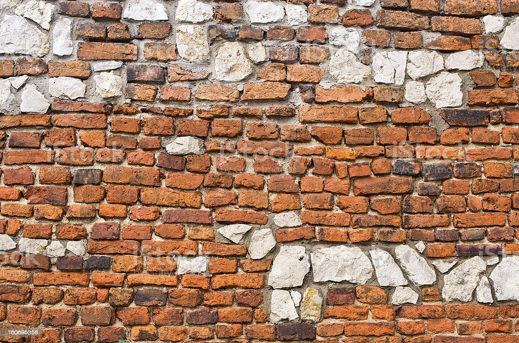 Brick wall with stones royalty-free stock photo