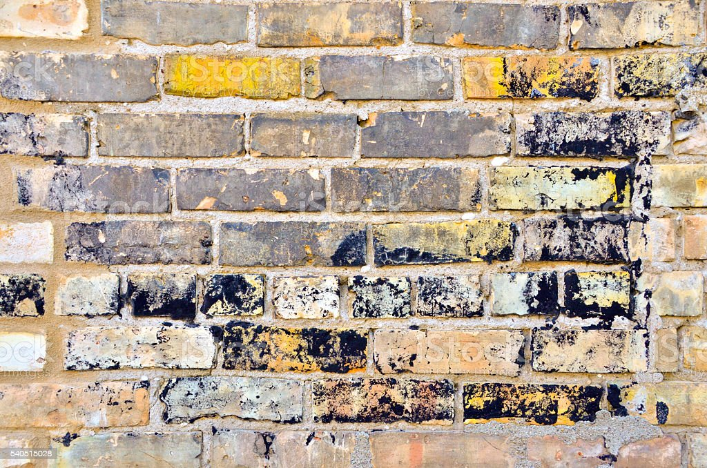 Brick Wall with Weathered Paint stock photo