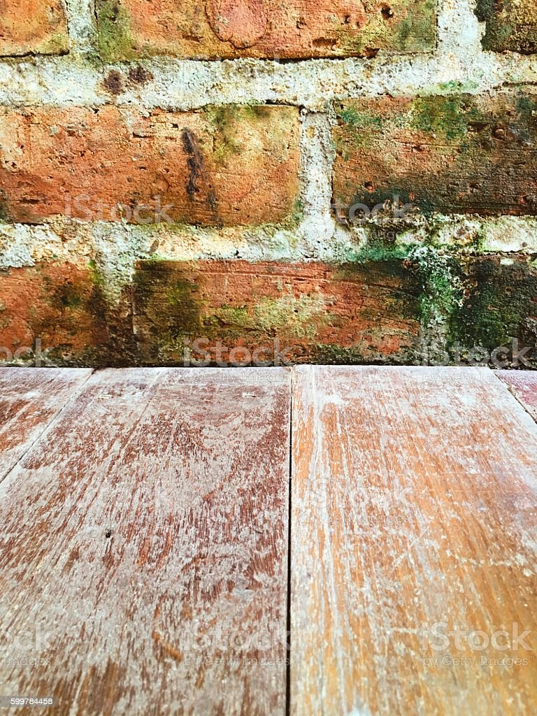 Brick wall with wooden floeer backgroud royalty-free stock photo