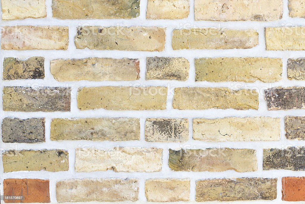 Brick wall with yellow and red stones royalty-free stock photo