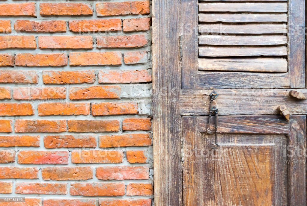 Brick wall, wooden window doors and chairs background stock photo