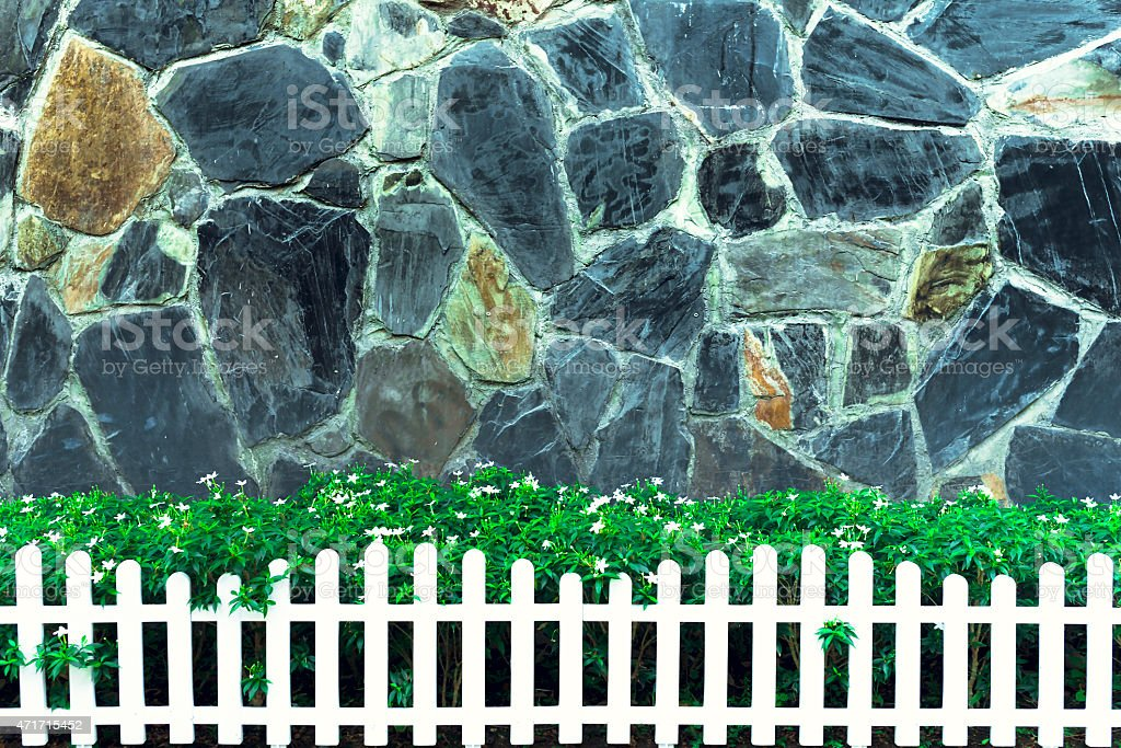 Brick Walls and small garden and white fence royalty-free stock photo