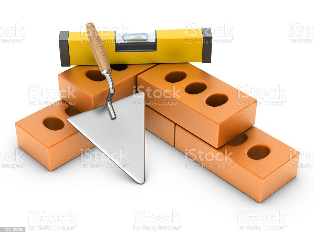 Brick with Spirit Level and Trowel royalty-free stock photo