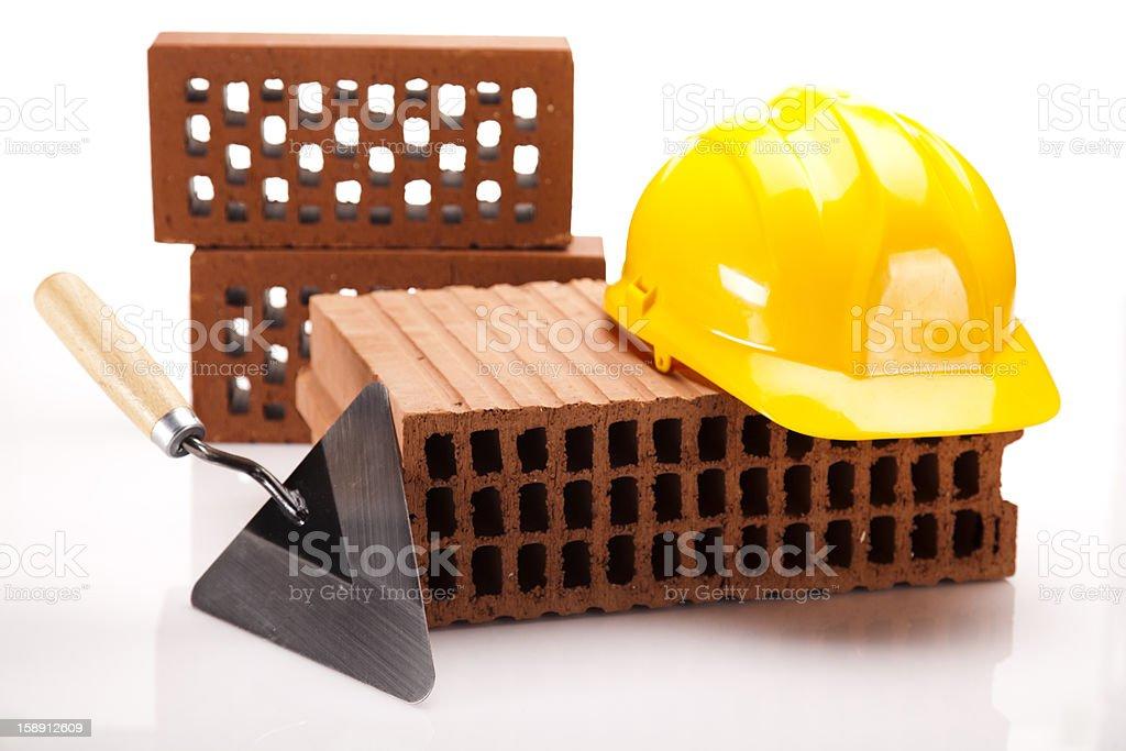 Brick, yellow hard hat, tools royalty-free stock photo