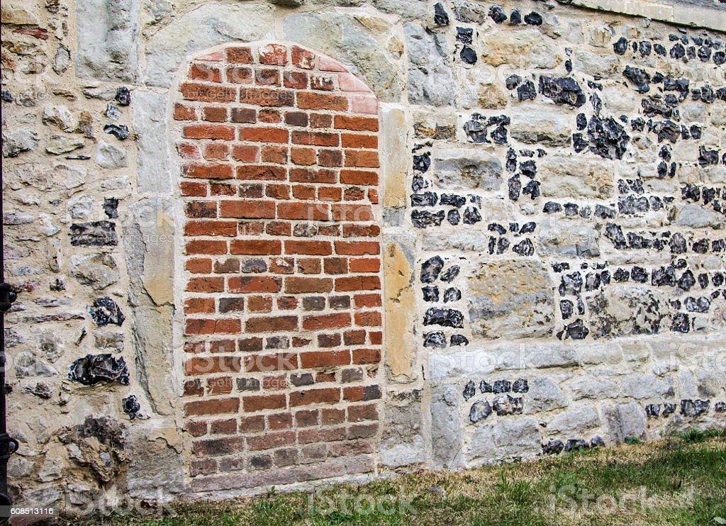 Bricked up doorway at church stock photo