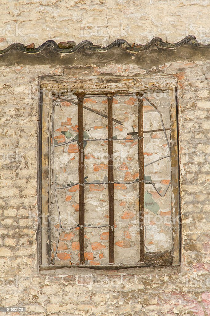 bricked-up barred window stock photo