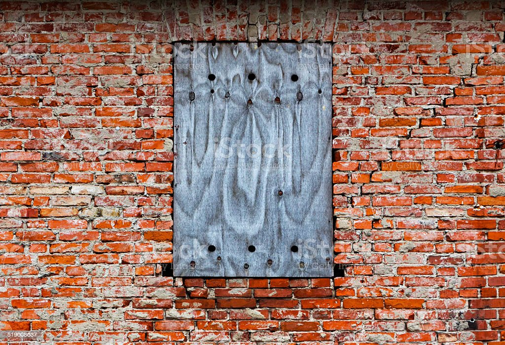 Bricked-up window on the old brick wall stock photo