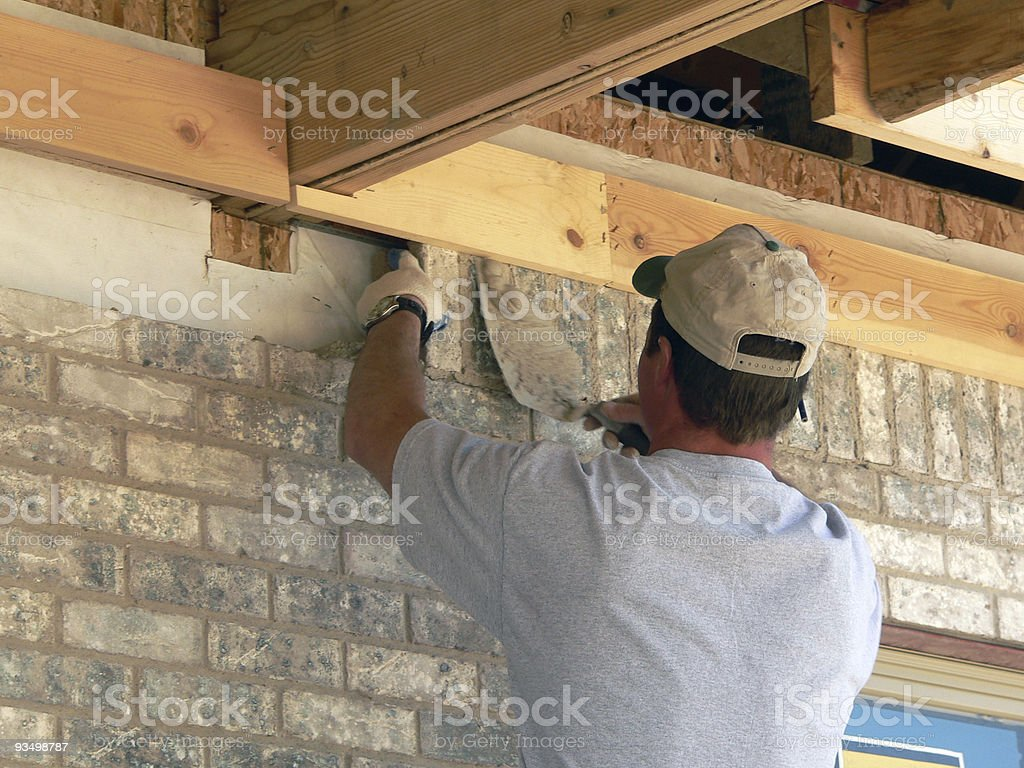 A bricklayer at work with a trowel stock photo