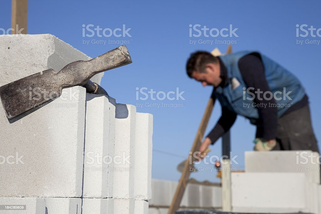 Bricklayer building a house. royalty-free stock photo