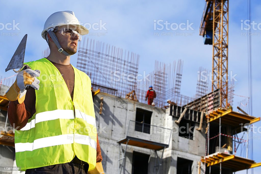 Bricklayer in a Building stock photo