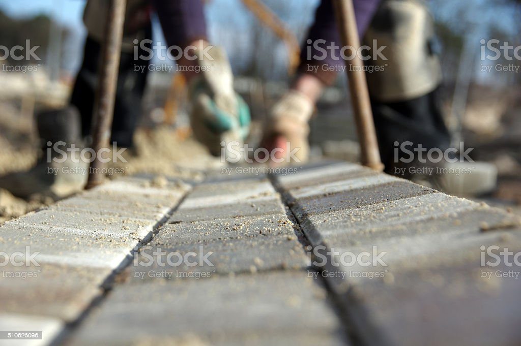 Bricklayer in action stock photo