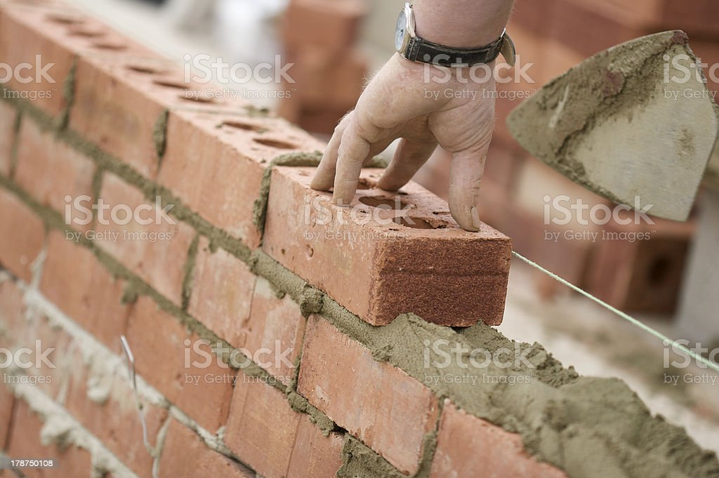 Bricklayer Laying Bricks royalty-free stock photo